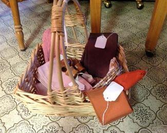 Basket full of vintage cloth napkins and napkin rings