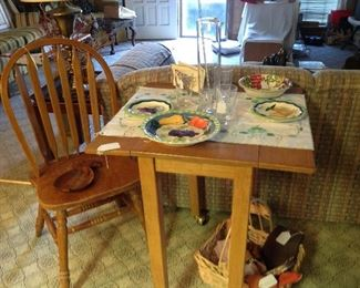 Neat small drop leaf table.  It's a rolling table, perfect for small spaces!