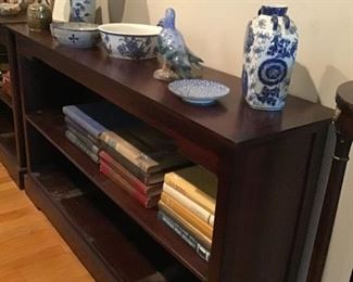 Large bookcase, old Gumbo yearbooks, blue and white decorative items