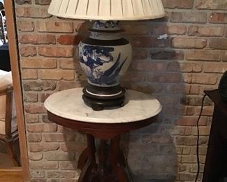 Antique marble top side table, beautiful blue and white Asian style lamp.