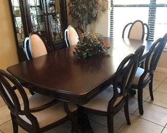 Beautiful Ashley dining room table with buffet and glass curio to match
