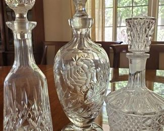 """202: 3 Beautiful Glass Decanters with an extra topper 3 Beautiful Glass Decanters with an extra topper. One topper does not come off. measures approx from 10"""" to 14.5"""""""