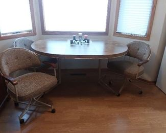 Kitchen table with 3 Herman Miller chairs