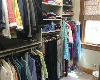 A full closet of womens  clothing