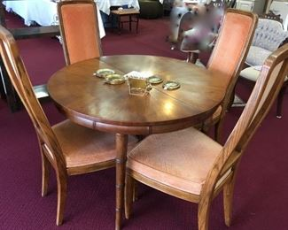 """Henredon mid-century table (40"""" round; add two 20"""" leaves = 80"""" long).  6 chairs as is."""