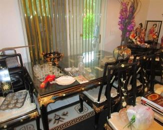Japanese Black lacquer and gilded table inlaid with mother of pearl figures and matching chairs