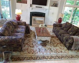 Pair of Couches, coffee table w/matching end table, matching lamps (the rug is not for sale)