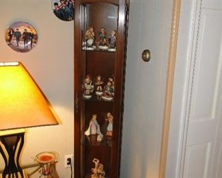 Curio cabinet with hummels