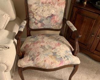 #7side chair w wood arms and legs cream flower patern back and seat  $65.00