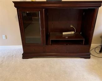 #15		entertainment cabinet w 3 drawers 1 glass door and 2 hid doors 65x22x50	 $75.00