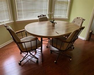 #24		laminate table with 4 rolling chairs w 1 leaf 42-59x42x29	 $125.00