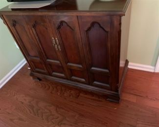 #25old tv cabinet w folding doors and shelves 45x19x35 $75.00
