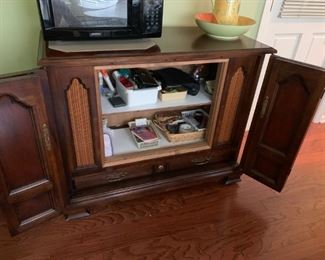#25		old tv cabinet w folding doors and shelves 45x19x35	 $75.00