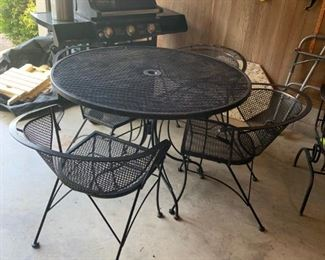 #58metal table and 4 chairs $75.00