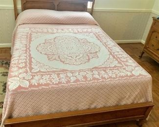 Mid-Century full size bed with pink and white coverlet