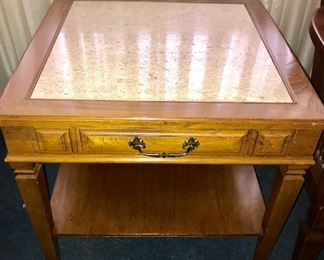 There are 2 of these vintage accent tables with granite insert