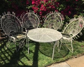 Wrought iron patio table. 3.5 foot diameter. 4 chairs.