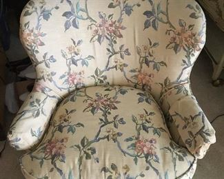 Patterned Queen Anne armchair matches sofa.