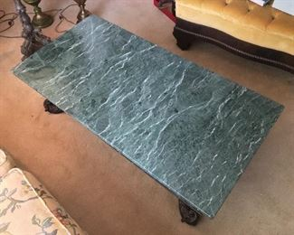Heavy marble and dark wood coffee table. A one of a kind piece!
