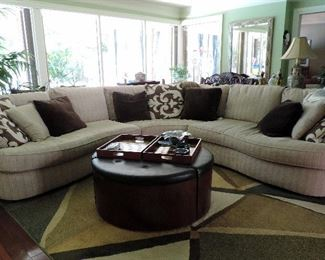 CUSTOM MID CENTURY STYLE SOFA AND PILLOWS, ROUND LEATHER COFFEE TABLE