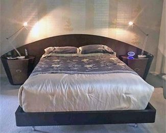 Custom Made Bed solid wood bed with Attached Night Stands on either Side. Black and Dark Wood Tone with Curved Design. Very Modern. Please note that this does not include the mattress, Bed Spread or any of the items seen on the night stands. This is for the Bed Set Only.