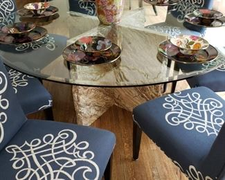 Two round glass top tables with stone bases