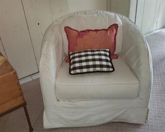 Pair of slip covered swivel armchairs