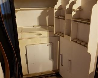 The inside of the safe with pull out drawer, storage for food and built in not working refrigerator