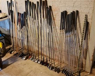 Golf clubs, Cleveland, Callaway, assorted putters and irons, assorted woods