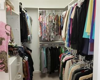 Closet filled with ladies clothing