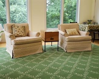 Pair of armchairs on the room size rug that is approximately 15 feet 9 inches by 16 feet 1 inch
