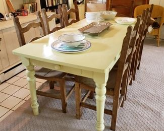 Painted dining table with drawer on each end and a set of eight matching side chairs