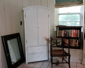 White wicker wardrobe and the armchair of the matching Hitchcock side chairs