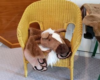 Wicker armchair with a horse rug