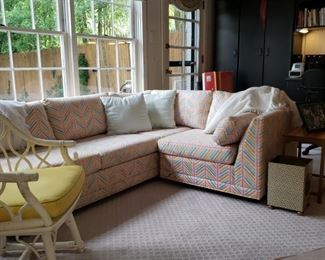Sectional sofa and a glimpse of a rattan painted armchair