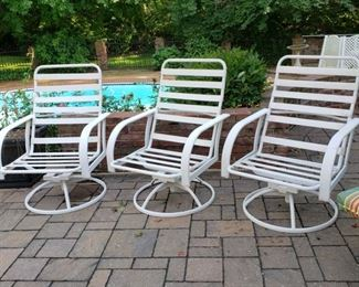 Three swivel rockers without cushions