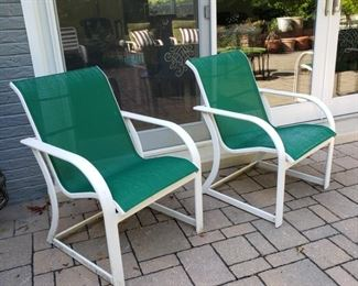 Set of four green and white sling armchairs