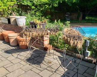 Pair of metal planters and other planters
