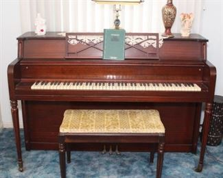 Story and Clark piano with bench.