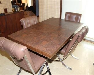 Kitchen table with removable leaf and four chairs.