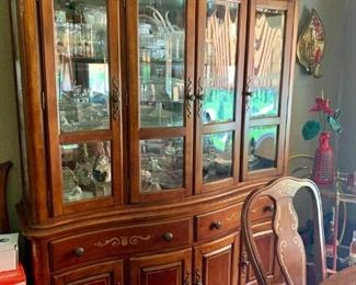 China cabinet full of glass and crystal items