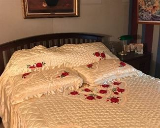 Bed with vintage bedspread in excellent condition .