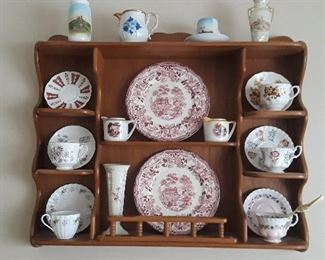 Assorted cups and saucers and decorative shelf