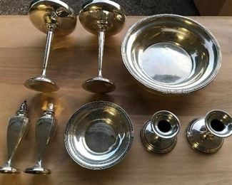 Sterling silver bowls, candlesticks and salt and pepper shakers.