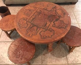Circa 1956 Hand tooled leather child's table and stools- beautiful condition