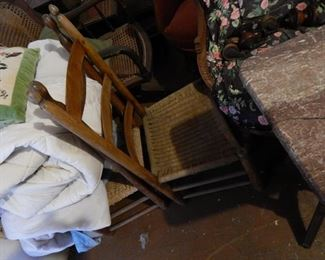 Set of 4 short ladderback chairs with cane seats.