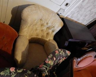 Deeply padded, button-tufted armchair in beige brokade. Very comfy.