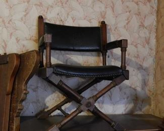 Low, directors-style chair in black leather.