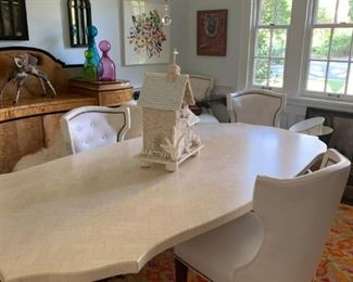 Oly Dining Table and stunning white leather chairs. 95 x 45 x 30H Hand pieced Limestone on metal legs. MSRP $5,275