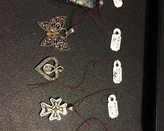 Some solid mixed metal pendants